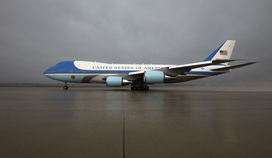 FILE - In this April 6, 2017 file photo, Air Force One, with President Donald Trump aboard, departs from Andrews Air Force Base, Md., en route to Mar-a-Largo, in Palm Beach, Fla., for a meeting with Chinese President Xi Jinping. Trump says Air Force One is getting a patriotic makeover. Trump says the familiar baby blue color on current models of the presidential aircraft will give way to red-white-and-blue coloring on updated models that could be in service in time for a potential second term. ( AP Photo/Jose Luis Magana)
