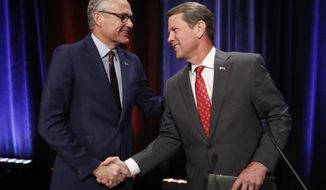 FILE - In this July 12, 2018, file photo, Republican candidates for Georgia governor, Lt. Gov. Casey Cagle, left, and Secretary of State Brian Kemp. shake hands after an Atlanta Press Club debate at Georgia Public Television in Atlanta. The two will face each other July 24 in a primary runoff for the Republican nomination. President Donald Trump endorsed Kemp over Cagle for Georgia governor Wednesday, July 18, just days before voters decide the contentious Republican runoff. (AP Photo/John Bazemore, File)
