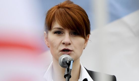 In this photo taken on Sunday, April 21, 2013, Maria Butina, leader of a pro-gun organization in Russia, speaks to a crowd during a rally in support of legalizing the possession of handguns in Moscow, Russia. Butina, a 29-year-old gun-rights activist, served as a covert Russian agent while living in Washington, gathering intelligence on American officials and political organizations and working to establish back-channel lines of communications for the Kremlin, federal prosecutors charged Monday, July 16, 2018. (AP Photo)