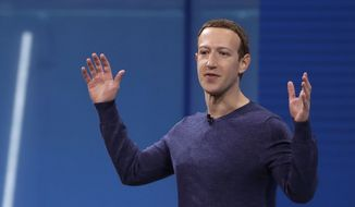 "In this May 1, 2018, file photo, Facebook CEO Mark Zuckerberg makes the keynote address at F8, Facebook's developer conference in San Jose, Calif. Remarks from Zuckerberg have sparked criticism from groups such as the Anti-Defamation League. Zuckerberg, who is Jewish, told Recode's Kara Swisher in an interview that although he finds Holocaust denial ""deeply offensive,"" such content should not be banned from Facebook. (AP Photo/Marcio Jose Sanchez, File)"