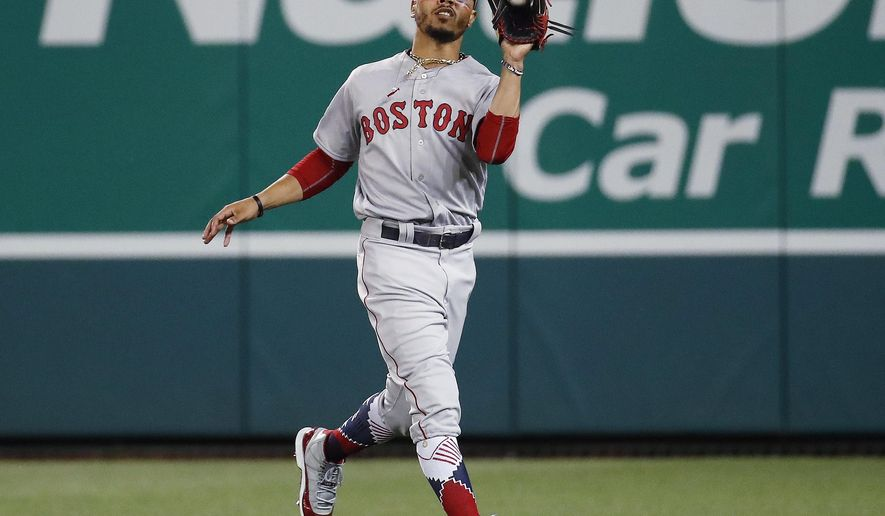 Boston Red Sox outfielder Mookie Betts (50) catches a fly ball hit by Chicago Cubs Javier Baez in the fifth inning of the Major League Baseball All-star Game, Tuesday, July 17, 2018 in Washington. (AP Photo/Alex Brandon)