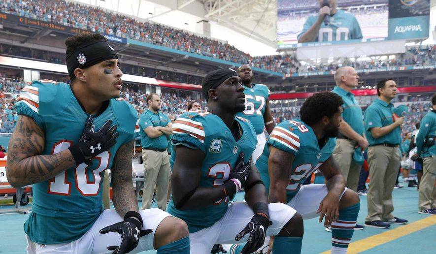 FILE - In this Sunday, Oct. 23, 2016, file photo, Miami Dolphins wide receiver Kenny Stills (10), free safety Michael Thomas (31) and defensive back Chris Culliver (29) kneel during the National Anthem before the first half of an NFL football game against the Buffalo Bills in Miami Gardens, Fla. Miami Dolphins players who protest on the field during the national anthem this season could be suspended for up to four games under a new team policy issued to players this week. The policy obtained by The Associated Press on Thursday, July 19, 2018 classifies anthem protests as conduct detrimental to the club, punishable by suspension without pay, a fine or both. (AP Photo/Wilfredo Lee) ** FILE **