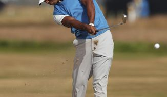 Tiger Woods of the US plays a shot on the 7th hole during the first round of the British Open Golf Championship in Carnoustie, Scotland, Thursday July 19, 2018. (AP Photo/Jon Super)