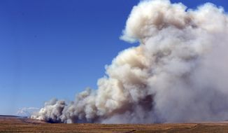 A fast-moving fire continues to rage across Wasco County southeast of The Dalles, Ore., Wednesday, July 18, 2018. The deadly fire reached 36,000 acres Wednesday, July 18, 2018. The blaze Wednesday doesn't bode well for a Pacific Northwest fire season that's expected to be worse than normal. The region has seen drought conditions in many areas.  (Mark Graves/The Oregonian via AP)