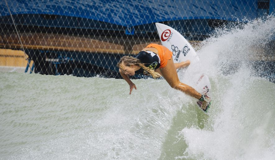 Bethany Hamilton rides a wave at the WSL Surf Ranch on Wednesday, July 18, 2018, in Lemoore, Calif. Hamilton is back on her surfboard four months after giving birth to her second son, and has earned a wildcard spot in the first Surf Ranch Pro in September. Now 28, Hamilton lost her left arm to a tiger shark at age 13. (Poor Boyz Productions via AP)