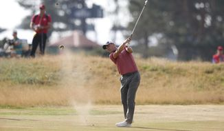 Martin Kaymer of Germany plays a shot on the 9th hole during the first round of the British Open Golf Championship in Carnoustie, Scotland, Thursday July 19, 2018. (AP Photo/Alastair Grant)
