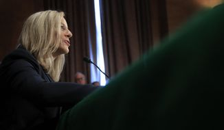 Kathleen Kraninger, President Donald Trump's nominee to be the director of the Bureau of Consumer Financial Protection, testifies before a Senate Banking Committee hearing on her confirmation on Capitol Hill in Washington, Thursday, July 19, 2018. (AP Photo/Manuel Balce Ceneta)