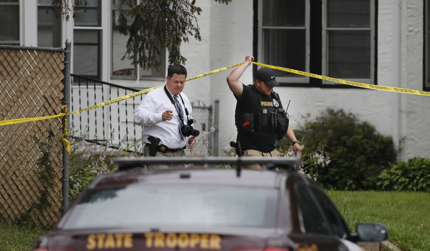 CORRECTS THE NUMBER OF OFFICERS SHOT TO A FEW, NOT ONE - Police officers investigate the scene of a shooting between a suspect and a South St. Paul police officer in South St. Paul, Minn., Thursday, July 19, 2018. Authorities say a few South St. Paul officers have been shot and wounded. South St. Paul issued a statement Thursday afternoon which says the officer is currently at the hospital being treated. It says the suspect has been taken into custody and is not injured. (Richard Tsong-Taatarii/Star Tribune via AP)
