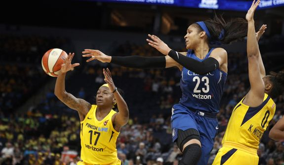 Minnesota Lynx Maya Moore passes the  ball to a teammate during a WNBA basketball game against the Indiana Fever, Wednesday, July 18, 2018 in Minneapolis. (Jerry Holt/Star Tribune via AP) **FILE**