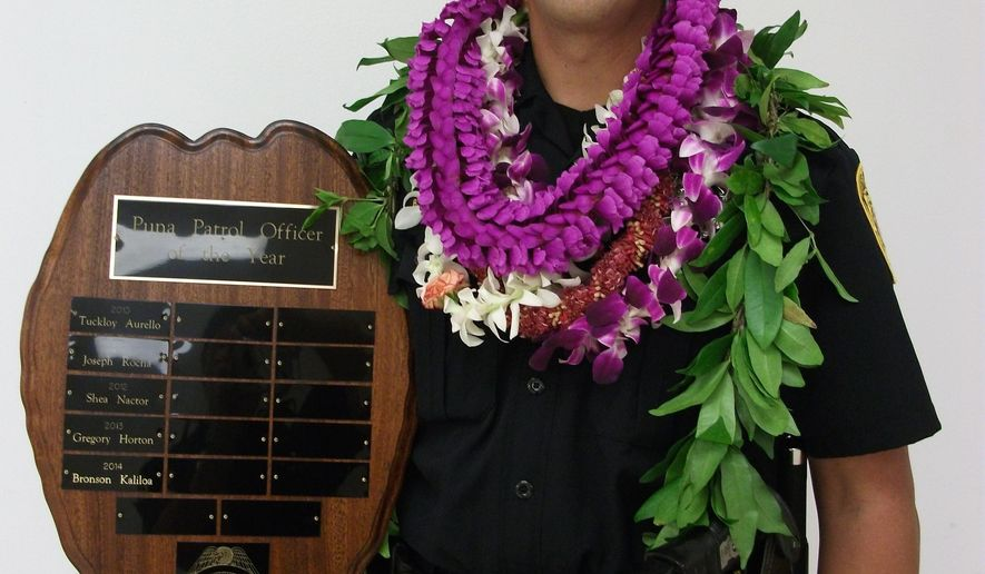 FILE - This undated file photo provided by the Hawaii County Police Department shows Officer Bronson Kaliloa. Hawaii's entire Big Island police force was on alert Wednesday, July 18, 2018, for Justin Joshua Waiki, a suspect wanted in the killing of Kaliloa during a traffic stop, including off-duty officers and some who returned to work from vacation and days off to join in the search. (Hawaii County Police Department via AP, File)
