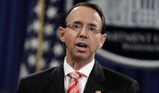 FILE - In this July 13, 2018, file photo, Deputy Attorney General Rod Rosenstein speaks during a news conference at the Department of Justice. Rosenstein is defending the prosecution of foreign agents who may never see the inside of a U.S. courtroom. He says the prosecutions of agents involved in efforts to sow dissent in the U.S. political system or in cyber-attacks serves as a deterrent even when they are beyond the reach of U.S. authorities.(AP Photo/Evan Vucci)