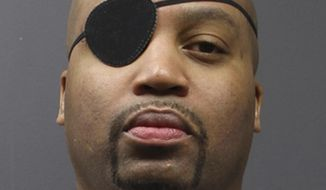 In this undated photo provided by the Minnesota Department of Corrections, Edward Muhammad Johnson is shown in a mugshot. Johnson, 42, is accused of using a weapon to attack Officer Joseph Gomm on Wednesday at Stillwater prison in Stillwater, Minn. Minnesota Corrections Commissioner Tom Roy says the attack happened in the prison's industry building and didn't describe the weapon. Johnson had been serving time for homicide. (Minnesota Department of Corrections via AP)