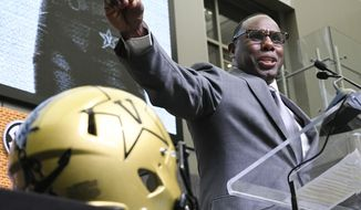 NCAA college football head coach Derek Mason of Vanderbilt speaks during the Southeastern Conference Media Days at the College Football Hall of Fame in Atlanta, Thursday, July 19, 2018. (AP Photo/John Amis)