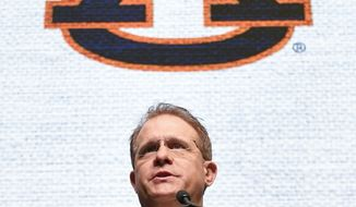 NCAA college football head coach Gus Malzahn of Auburn speaks during the Southeastern Conference Media Days at the College Football Hall of Fame in Atlanta, Thursday, July 19, 2018. (AP Photo/John Amis)
