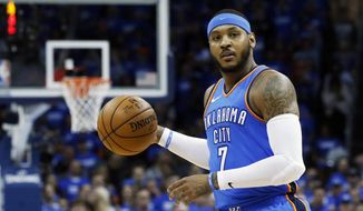 FILE - This is an April 25, 2018, file photo showing Oklahoma City Thunder forward Carmelo Anthony (7) during Game 5 of an NBA basketball first-round playoff series against the Utah Jazz, in Oklahoma City. Carmelo Anthony is done in Oklahoma City. A person with knowledge of the details tells The Associated Press the Thunder are sending the veteran NBA forward and a 2022 protected first-round pick to Atlanta in exchange for Hawks guard Dennis Schroder and Mike Muscala. (AP Photo/Sue Ogrocki, File) ** FILE**