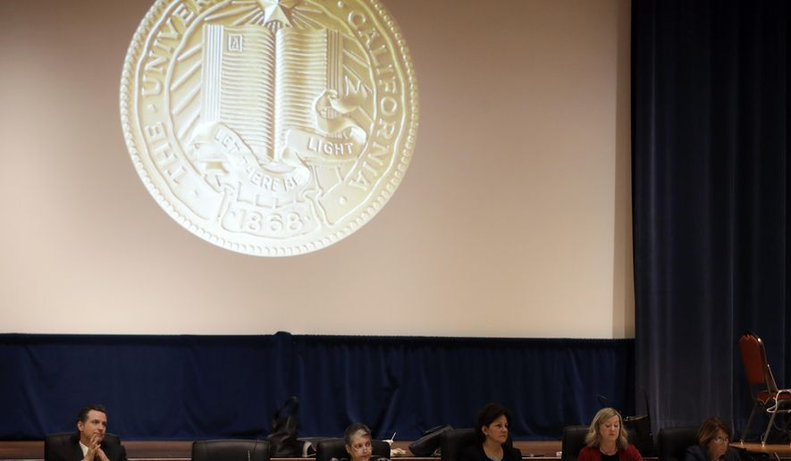 In this Jan. 25, 2017, file photo, members of the University of California Board of Regents listen to testimony from employees and students in San Francisco. The University of California will lower tuition by $60 for the upcoming academic year. The UC Board of Regents approved the decrease Thursday. It's the university system's first tuition decrease in nearly two decades. (AP Photo/Marcio Jose Sanchez, File)