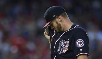 Washington Nationals starting pitcher Stephen Strasburg wipes his face between throws during the fifth inning of a baseball game against the Atlanta Braves at Nationals Park in Washington, Friday, July 20, 2018. (AP Photo/Susan Walsh) **FILE**