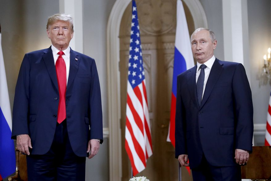 U.S. President Donald Trump, left and Russian President Vladimir Putin, right, stand together before the start of their meeting at the Presidential Palace in Helsinki, Finland, Monday, July 16, 2018. (AP Photo/Pablo Martinez Monsivais)