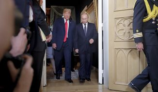 U.S. President Donald Trump, left, and Russian President Vladimir Putin, right, arrive for a one-on-one-meeting at the Presidential Palace in Helsinki, Finland, Monday, July 16, 2018. (AP Photo/Pablo Martinez Monsivais)
