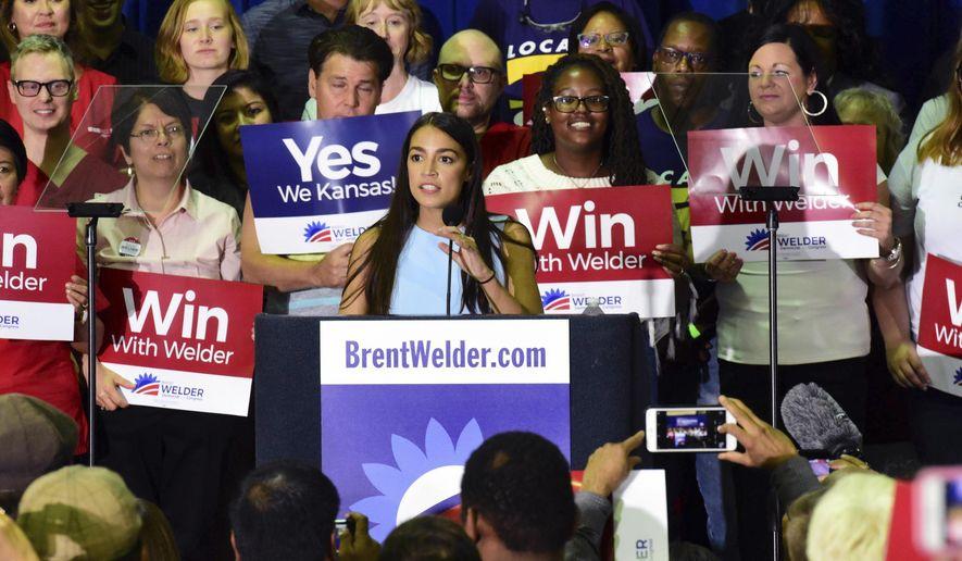 New York congressional candidate Alexandra Ocasio-Cortez speaks in support of Kansas Democrat Brent Welder at Jack Reardon Convention Center on Friday, July 20, 2018, in Kanas City, Kan. (Luke Harbur /The Kansas City Star via AP)