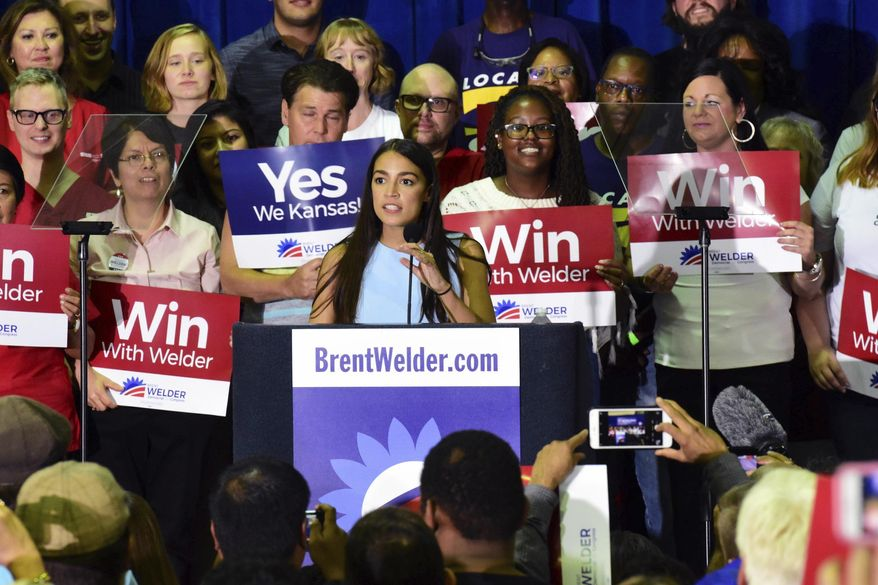 New York congressional candidate Alexandra Ocasio-Cortez speaks in support of Kansas Democrat Brent Welder at Jack Reardon Convention Center on Friday, July 20, 2018, in Kanas City, Kan. (Luke Harbur /The Kansas City Star via AP)