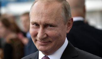 Russian President Vladimir Putin smiles as he visits the Kaliningrad Stadium after the 2018 soccer World Cup in Kaliningrad, Russia, Friday, July 20, 2018.(Alexei Nikolsky, Sputnik, Kremlin Pool Photo via AP)