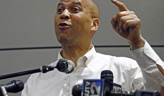 U.S. Sen. Cory Booker, D-N.J., speaks on behalf of Democrat Mike Espy, unseen, and his race in a special election to fill the final two years of a term started by Mississippi Republican Thad Cochran, in Jackson, Miss., Friday, July 20, 2018. Republican Sen. Cindy Hyde-Smith was appointed to temporarily succeed Cochran, and she is running for the seat. (AP Photo/Rogelio V. Solis) **FILE**