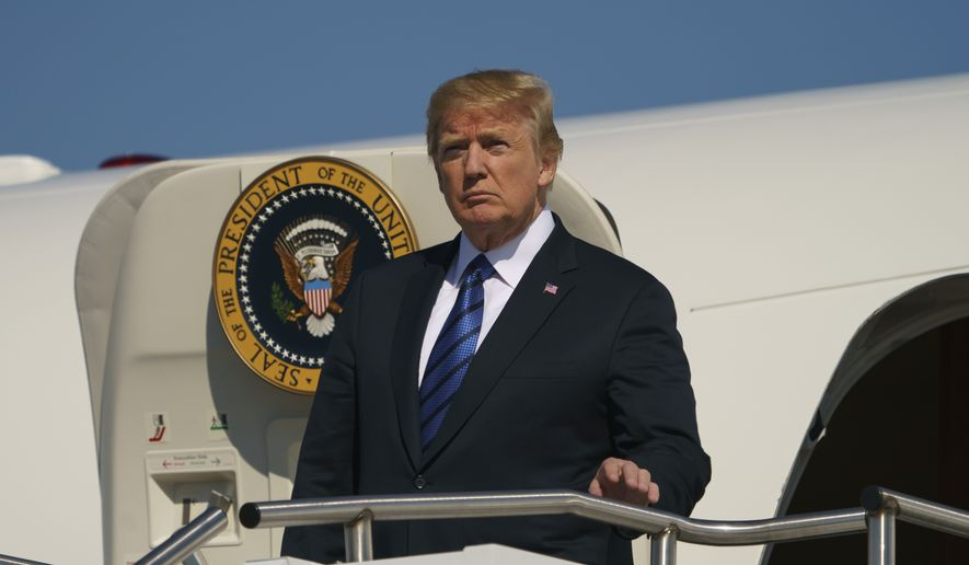 President Donald Trump arrives on Air Force One at Morristown Municipal Airport, in Morristown, N.J., Friday, July 20, 2018, en route to Trump National Golf Club in Bedminster, N.J.. (AP Photo/Carolyn Kaster)