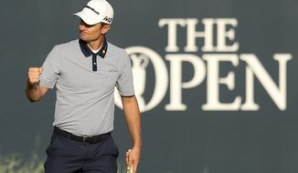 Justin Rose of England finishes the second round of the British Open Golf Championship in Carnoustie, Scotland, Friday July 20, 2018. (AP Photo/Jon Super)