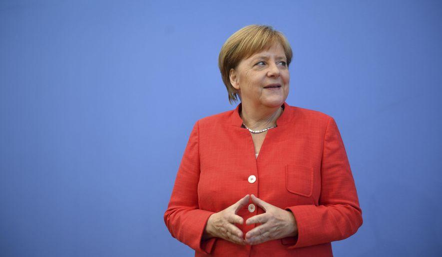 German Chancellor Angela Merkel waits for the beginning of her annual summer press conference in Berlin Friday, July 20, 2018. (Bernd Von Jutrczenka/dpa via AP)
