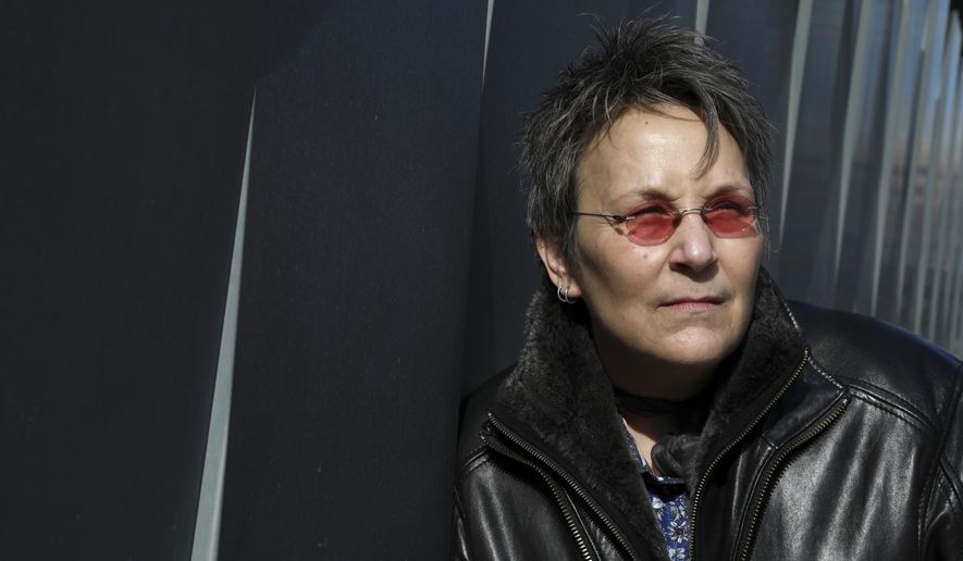 """In this Feb. 8, 2018 photo, musician Mary Gauthier poses for a portrait in New York to promote her veteran inspired record """"Rifles & Rosary Beads.""""  (Photo by Amy Sussman/Invision/AP)"""