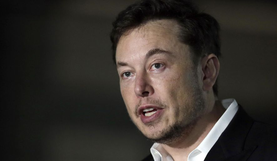 In this Thursday, June 14, 2018 file photo, Tesla CEO and founder of the Boring Company Elon Musk speaks at a news conference, in Chicago. (AP Photo/Kiichiro Sato, File)
