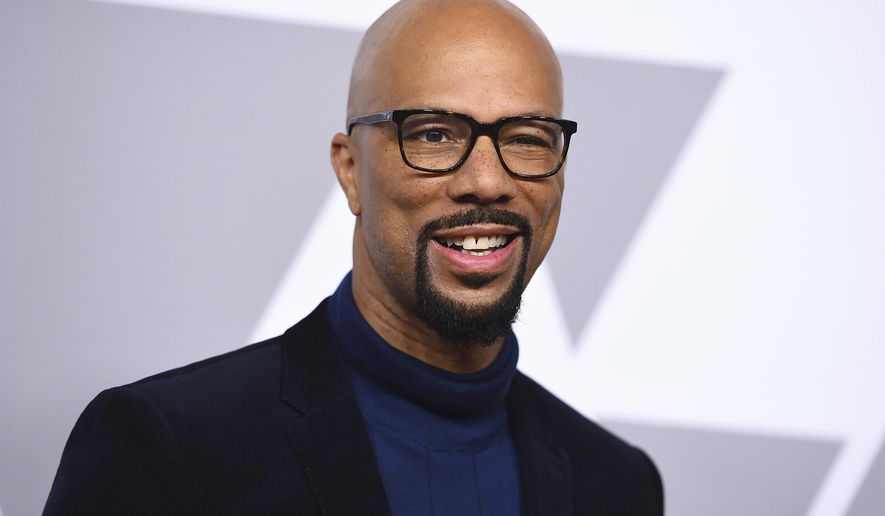 FILE - In this Feb. 5, 2018 file photo, Common arrives at the 90th Academy Awards Nominees Luncheon in Beverly Hills, Calif. Common showed up at P.S. 111 in midtown Manhattan on Thursday as an ambassador for the Adopt-A-Classroom initiative. He made the surprise appearance with his mother, Dr. Mahalia Hines, to present the school with a $10,000 check. (Photo by Jordan Strauss/Invision/AP, File)