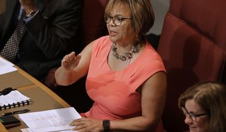 FILE - In this July 16, 2018, file photo, Charlotte Mayor Vi Lyles speaks to a packed chamber during a public forum before the Charlotte City Council votes whether to host the 2020 Republican National Convention in Charlotte, N.C. As Charlotte, North Carolina, celebrates being chosen Friday, July 20, to host the 2020 Republican National Convention, an undercurrent of concern about the potential for violence runs through the Democratic-leaning city. Lyles led the campaign to bring the convention to Charlotte and said in a newspaper column that it would be a chance for the city to show its inclusiveness. (AP Photo/Chuck Burton, File)
