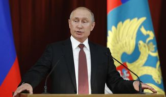"""Russian Vladimir Putin speaks during a meeting with Russian ambassadors to foreign countries in Moscow, Russia, Thursday, July 19, 2018. Putin says his first summit with U.S. President Donald Trump was """"successful"""" and is accusing Trump's opponents in the U.S. of hampering any progress on the issues they discussed. (Sergei Karpukhin/Pool Photo via AP)"""