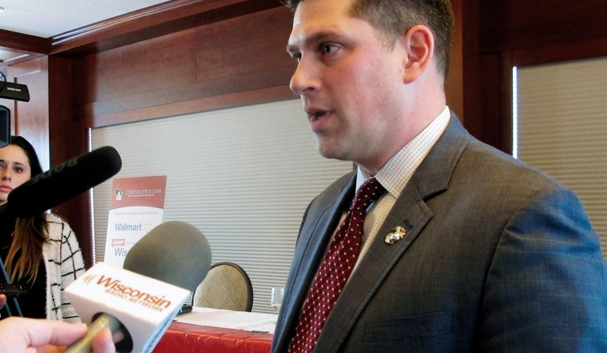 """FILE - In this Jan. 30, 2018 file photo, Wisconsin Republican Senate candidate Kevin Nicholson speaks with reporters in Madison, Wis. In an op-ed for Fox News published on Monday, July 16, 2018, Nicholson wrote about his parents' support for his challenger, Democratic Sen. Tammy Baldwin. Nicholson says his parents' decision to support his Democratic opponent is a """"true representation"""" of political intolerance. (AP Photo/Scott Bauer, File)"""