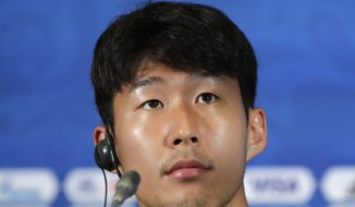In this June 26, 2018 photo, South Korea's Son Heung-min listens to reporter's question during the press conference before the South Korea's official training on the eve of the group F match between South Korea and Germany at the 2018 soccer World Cup in the Kazan Arena in Kazan, Russia. Tottenham winger Son Heung-min could miss the start of the Premier League season after being selected by South Korea to play in the Asian Games in Indonesia. (AP Photo/Lee Jin-man)