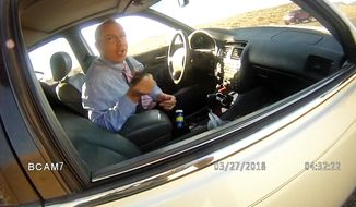 File - This file image made from a March 27, 2018, law enforcement body camera video from the La Paz County Sheriff's Office, via KLPZ / ParkerLiveOnline, shows Arizona state Rep. Paul Mosley during a traffic stop outside Parker, Ariz. Records show an Arizona lawmaker already under fire for claiming legislative immunity during a traffic stop for speeding has had similar run-ins with state police, and only got a warning each time. According to Department of Public Safety documents obtained by The Arizona Republic Tuesday, July 17, 2018, Rep. Paul Mosley was pulled over by troopers six times since February 2017. (La Paz County Sheriff's Office/KLPZ/ParkerLiveOnline via AP, File)