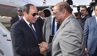 In this photo released by the Egyptian Presidency, Egyptian President Abdel-Fattah el-Sissi, left, is greeted by Sudanese President Omar al-Bashir on his arrival to  Khartoum, Sudan, Thursday, July 19, 2018. (Egyptian Presidency via AP)