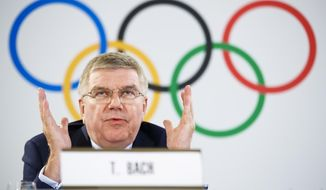 International Olympic Committee (IOC) President Thomas Bach from Germany attends a press conference after the executive board meeting of the IOC, in Lausanne, Switzerland, Friday, July 20, 2018. (Valentin Flauraud/Keystone via AP)