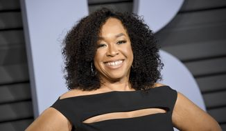 """FILE - In this March 4, 2018 file photo, Shonda Rhimes arrives at the Vanity Fair Oscar Partyin Beverly Hills, Calif. Rhimes's first slate of shows for Netflix include a look at the migration of African-Americans from the Jim Crow South, romance among wealthy 19th century Londoners and a documentary on Debbie Allen's reimagining of """"The Nutcracker."""" The streaming service on Friday announced eight shows Rhimes and her collaborators at Shondaland are developing. (Photo by Evan Agostini/Invision/AP, File)"""