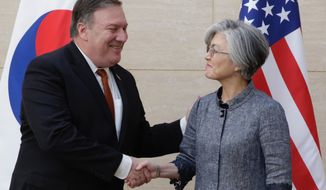 U. S. Secretary of State Mike Pompeo, left, shakes hands with South Korean Foreign Minister Kang Kyung-wha at South Korea's mission, Friday, July 20, 2018 in New York. (AP Photo/Richard Drew)