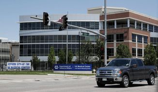 In this June 8, 2017, file photo, the campus of the Veterans Administration hospital is shown under construction in Aurora, Colo. (AP Photo/David Zalubowski, File) **FILE**