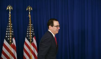 U.S. Treasury Secretary Steven Mnuchin attends a press gaggle with reporters in Buenos Aires, Argentina, Saturday, July 21, 2018. Mnuchin said Saturday that Donald Trump was not trying to put pressure on the Federal Reserve when he criticized its decision to raise interest rates. (AP Photo/Victor R. Caivano)