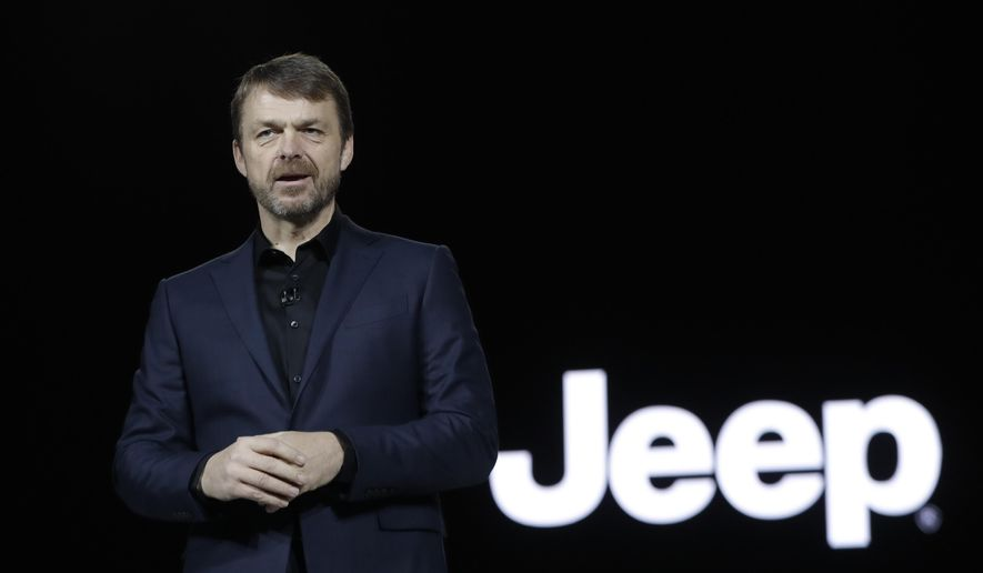 FILE - In this file photo dated Tuesday, Jan. 16, 2018, Mike Manley, head of Jeep Brand, introduces the 2019 Jeep Cherokee during the North American International Auto Show, in Detroit, USA.  Fiat Chrysler's board on Saturday July 20, 2018, has recommended Jeep executive Mike Manley to replace seriously ill CEO Sergio Marchionne. (AP Photo/Carlos Osorio, FILE)