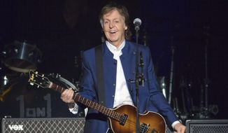 In this Monday, July 10, 2017, file photo, Sir Paul McCartney performs at Amalie Arena in Tampa, Fla. (AP Photo/Scott Audette)