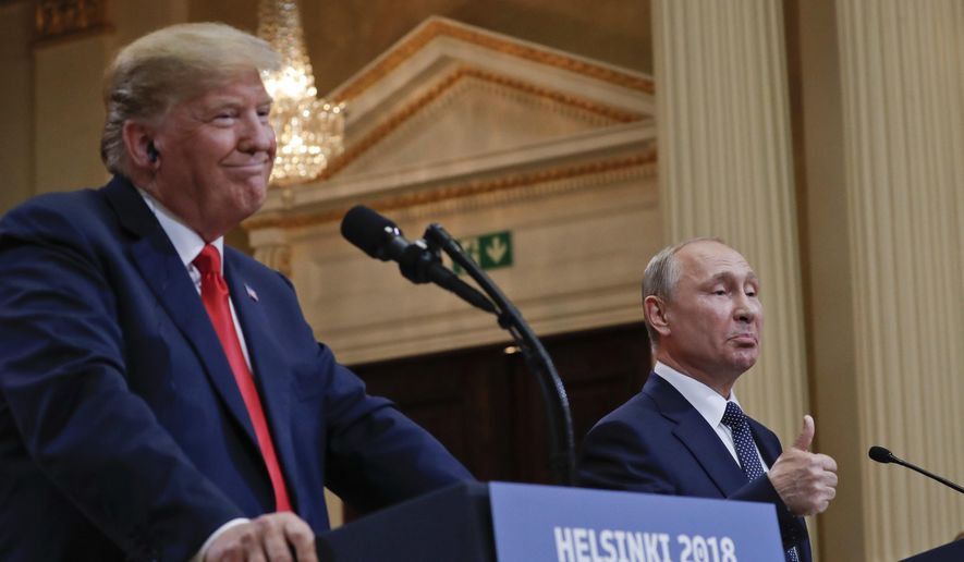 Russian President Vladimir Putin, right, and U.S. President Donald Trump give a joint news conference at the Presidential Palace in Helsinki, Finland, on Monday, July 16, 2018. (AP Photo/Pablo Martinez Monsivais)