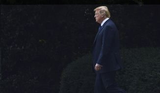 In this July 20, 2018, photo, President Donald Trump walks from the Oval Office of the White House in Washington, to board Marine One for a short trip to Andrews Air Force Base, Md., en route to Bedminster N.J., for the weekend. (AP Photo/Susan Walsh)