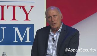 In this image from video provided by the Aspen Security Forum, National Intelligence Director Dan Coats speaks at the Forum in Aspen, Colo., on Thursday, July 19, 2018. Coats says his Thursday comments at the Aspen Security Forum in Colorado were not intended to be critical of the president's handling of the summit. (Aspen Security Forum via AP)