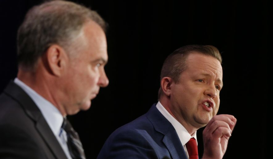 U.S. Sen. Tim Kaine, left, listens as Republican challenger Corey Stewart, right, gestures during the Virginia Bar Association debate at the Homestead in Hot Springs , Va., Saturday, July 21, 2018. (AP Photo/Steve Helber) ** FILE **